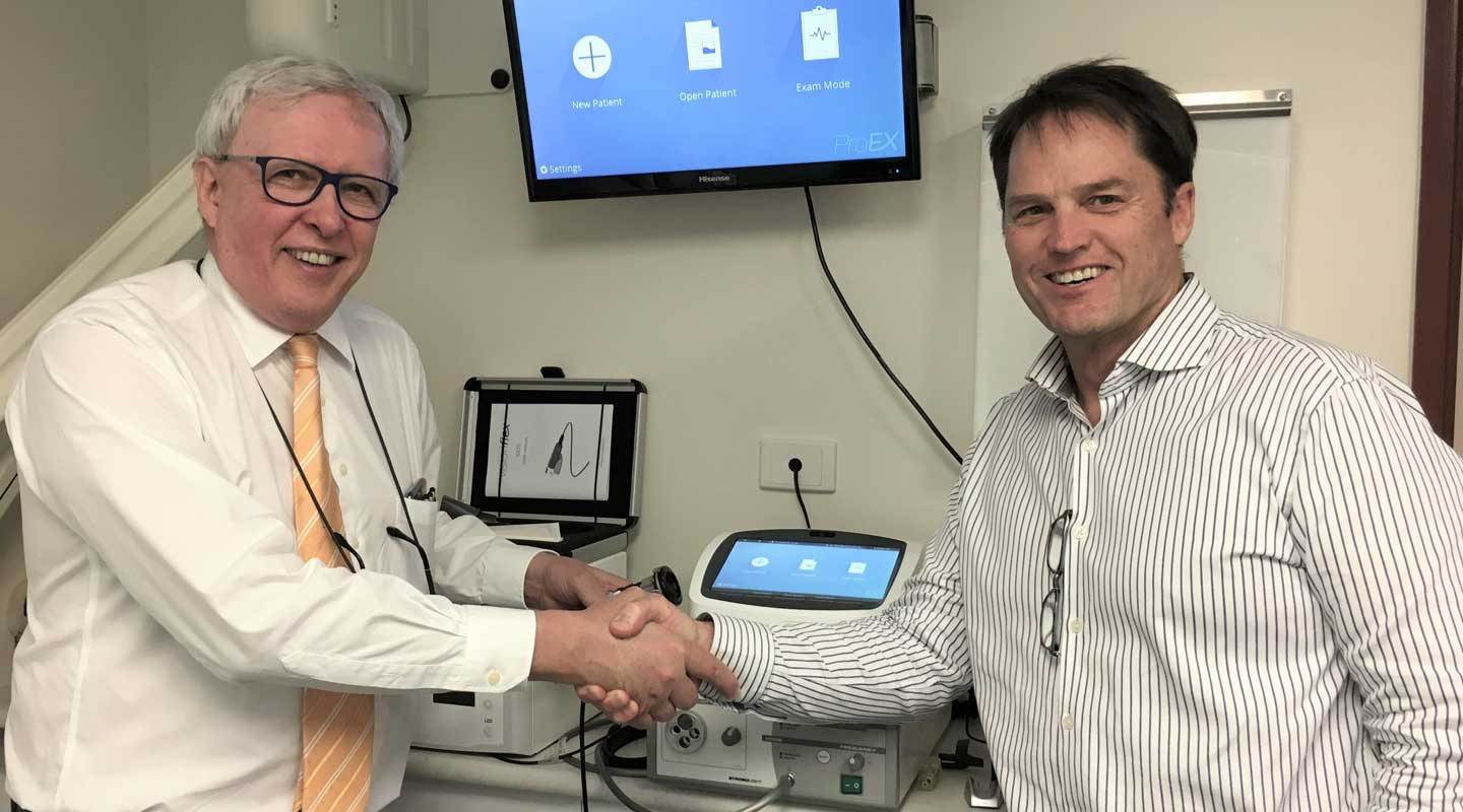 Dr Chris Perry with Mike Harman after receiving Visionflex ProEX Telehealth Device to streamline practice workflows